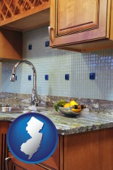 new-jersey map icon and a granite countertop